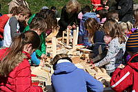 Photo showing Children working with wood during World Wood Day 2019, Stuebing, Austria. Photo: IUFRO.
