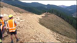 Photo showing a sand/gravel road on a slope in New Zealand. Photograph by Prof Rien Visser.