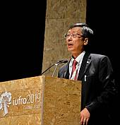 Photo showing IUFRO Vice-President Shirong Liu at 2019 IUFRO World Congress in Curitiba, Brazil. Photo courtesy of Congress Organizing Committee.