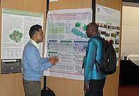 4th World Agroforestry Congress: Mr. Rahul Karki, Forest Action Nepal, explaining  his findings to a visitor during the poster session. Photo : Dr. Swoyambhu Man Amatya.