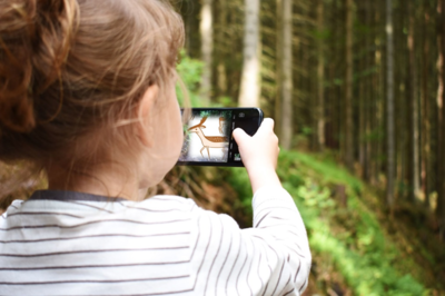 Photo showing child with smart phone in a forest. By Анна Куликова from Pixabay (edited).