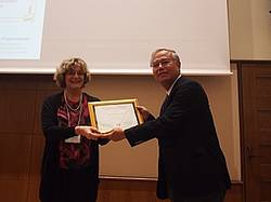 Photo showing the 7.01.00 award 2017 for achievements in air pollution and climate change impacts on forest ecosystems being awarded to Prof. Takayoshi Koike, from Hokkaido University in Japan, as recognition of his outstanding merits as a scientist and as a mentor of young scientists. Photo: IUFRO Tokyo 2017.