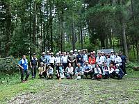 """Photo showing Participants visiting a Japanese red-cedar """"Sugi"""" stand in Oka family's private forest where thinning operations were recently performed"""