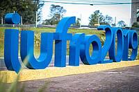 Photo showing big iufro2019 logo outside the congress centre.