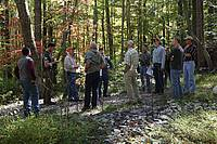 Photo showing Participants Mensurationist conference in the field excursion to the Reynolds Homestead in the Piedmont region of Virginia toured research studies aimed an improved management of pines and of hardwood species.