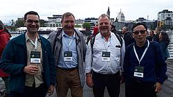Photo showing Conference participants at the closing ceremony, Valdivia 218: from left to right: Juan Blanco (Spain), Alexander Onuchin (Russia), David Ellison (Switzerland) and Adam Wei (Canada). Photo provided by Adam Wei.