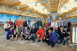 Photo showing NDTE of Wood symposium in Freiburg, 2019: Participants of the post-conference tour visiting a modern engineered timber roof construction.