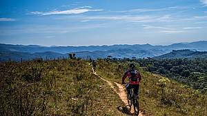 Photo showing cyclist on a mountain ridge: Tourism and recreation should receive just as much thought, science, and funding as other forest uses.