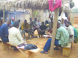 Picture showing villagers discussing the main causes of forest degradation