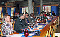 Photo showing Participants of International Symposium in Kuusamo, 2011, during lunch break.