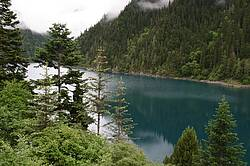 Photo showing Subalpine forests and lakes in western Sichuan Province, PR China. Photo by Sun Pengsen