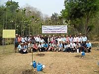 Photo showing World Teak Conference 2013: Delegates after teak planting.