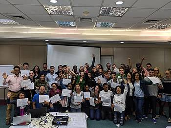 Learning beyond Classroom, Culture and Colour: Students and early career forestry professionals from many countries around the world joyfully pose with their certificate after participating in a training at the IUFRO 2019 Congress in Curitiba, Brazil. Photo credit: Khalil Walji, JTF Coordinator 2017-2019.