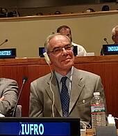 Photo showing IUFRO President Dr. John Parrotta