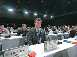 Photo showing IUFRO-GFEP's A Purret during Plenary session at CITES CoP 17