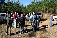Photo showing Participants of Mensurationist conference in the field excursion to the Reynolds Homestead in the Piedmont region of Virginia toured research studies aimed an improved management of pines and of hardwood species. Photo: Arne Pommerening