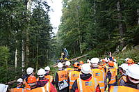 Photo showing Participants of the 5th Forest Engineering Conference as they watch steep-slope mechanized timber harvesting operations during a field excursion