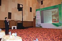Photo showing presenter speaking on IUFRO.