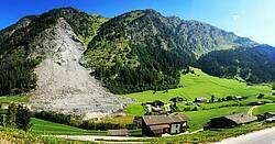 "Photo showing Rock avalanche in the GreenRisk4ALPs Pilot Action Region ""Gries am Brenner / Vals"" in Austria, endangering infrastructure, adjacent to protective forest reducing rockfall risk. Credit: Barbara Žabota, University of Ljubljana"